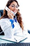 Portrait of medical professional busy on phone Royalty Free Stock Photos