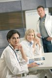 Portrait of medical team consulting Stock Photography