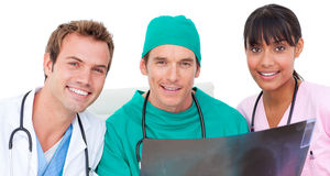 Portrait of medical team looking at X-ray Stock Photography