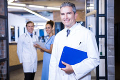 Portrait of medical team smiling at camera Royalty Free Stock Photos