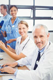 Portrait of medical team smiling in conference room Stock Photo