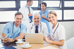 Portrait of medical team smiling in conference room Royalty Free Stock Images