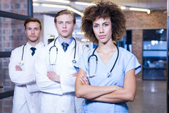 Portrait of medical team standing with arms crossed Stock Photos