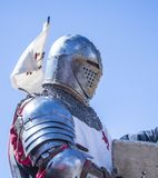 Medieval knight with helmet, portrait. Portrait of medieval knight with armor and helmet. Natural light. Armor of the XIV century Stock Images