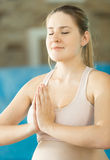 Portrait of meditating young smiling woman Royalty Free Stock Photo