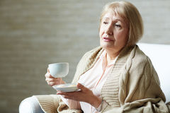 Portrait of melancholic senior woman Stock Image