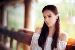 Portrait of a Melancholic Woman Wearing White Lace Top Royalty Free Stock Photos