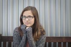 Portrait of Melancholy Teen Bookworm Girl Wearing Glasses Stock Photo