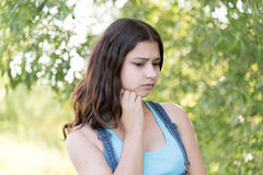 Portrait of melancholy teen girl on nature. Portrait of a sad teen girl on nature Royalty Free Stock Photos