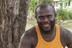 Portrait of a melanesian man smiling. Royalty Free Stock Image