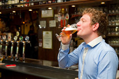 Portrait of men drinking beer at the pub Royalty Free Stock Photo