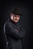 Portrait of men with hat in the darkness. Low key portrait of gangster with hat in the darkness Royalty Free Stock Image