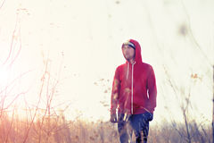 Portrait of men runner in the field with headlamp Royalty Free Stock Photo