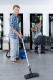 Portrait man vacuuming business premises. Portrait of men vacuuming business premises Royalty Free Stock Image