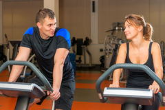 Portrait of men and women on exercise bikes Royalty Free Stock Images