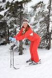 Portrait of merry young woman of skier Stock Image