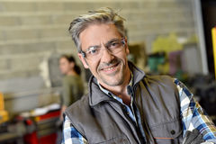 Portrait of metalworker. Portrait of middle-aged metalworker in workshop Stock Image