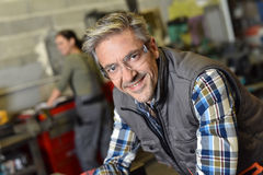 Portrait of metalworker. Portrait of middle-aged metalworker in workshop Royalty Free Stock Images