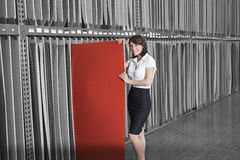 Portrait of mid adult businesswoman holding thin red veneer sheet Stock Image