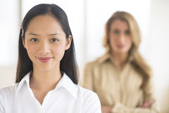 Portrait Of Mid Adult Businesswoman Smiling At Office Royalty Free Stock Photography