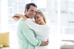 Portrait of mid adult couple hugging at home Royalty Free Stock Photos