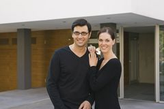 Portrait of a mid adult couple standing in front of a building and smiling Royalty Free Stock Photos