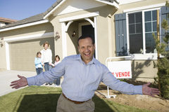 Portrait of mid-adult man in front of new house Stock Photography