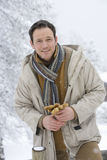 Portrait of mid adult man holding gloves in winter setting Stock Photography