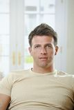 Portrait of mid-adult man at home Stock Images