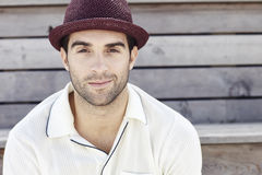 Portrait of mid adult man in red trilby Stock Image