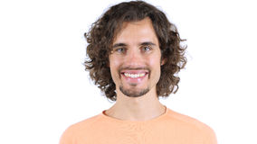 Portrait of mid adult man smiling against white background stock photo