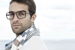 Portrait of mid adult man. Wearing scarf and spectacles Stock Image