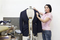 Portrait of a mid adult woman dressing mannequin Stock Images