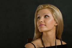 Portrait of a mid-adult woman looking side and up Stock Image