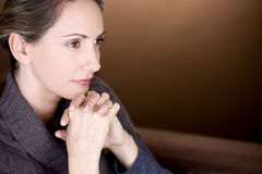 Portrait of a mid adult woman thinking stock image
