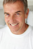 Portrait of mid age man. Smiling at camera Stock Photography