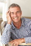 Portrait of mid age man at home. Smiling at camera Stock Images