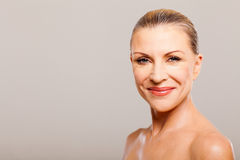 Mid age woman. Portrait of mid age woman smiling royalty free stock images