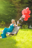 Portrait of Mid-Aged Woman sitting On Bench Stock Photo