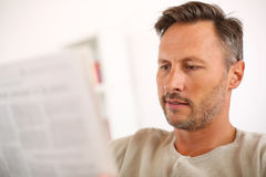 Portrait of midde-aged man reading newspaper Stock Photography
