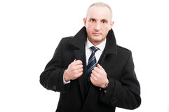 Portrait of middle age elegant man posing wearing overcoat. Isolated on white background with copy text space Stock Photography