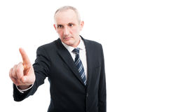 Portrait of middle age elegant man pushing button Royalty Free Stock Image