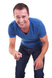 Portrait of a middle-age man pointing and laughing Stock Image
