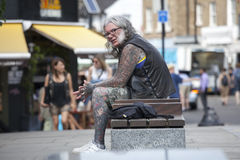 Portrait of a middle age man with tattoos, in a punk outfit Stock Photos