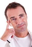 Portrait of a middle-age man thinking, looking up Royalty Free Stock Image