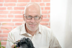 Portrait of a middle-age smiling photographer. In his studio Stock Photos