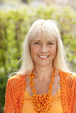 Portrait of a middle age woman in nature royalty free stock photos