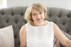 Portrait of middle age woman in the room stock photography