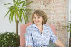 Portrait of middle age woman in the room royalty free stock image
