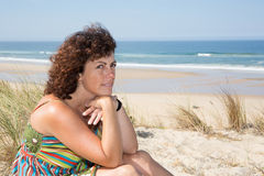 Portrait of a middle-aged brunette woman on the beach Stock Photography